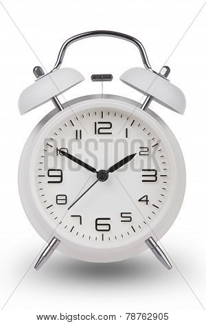 White Alarm Clock With The Hands At 10 And 2