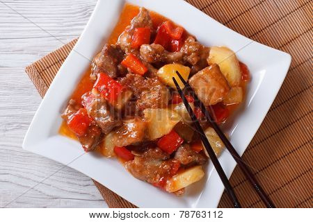 Asian Pork With Pineapple On A Plate Close-up. Top View Horizontal