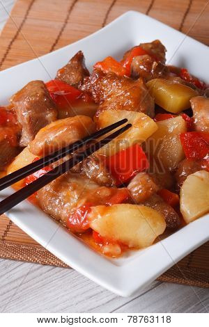 Asian Pork Meat With Pineapple On A Plate Close-up. Vertical