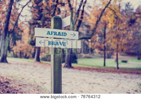 Rustic Wooden Sign With The Words Afraid- Brave