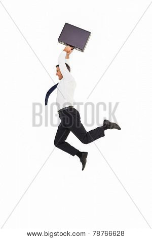 Smiling businessman leaping while briefcase on white background