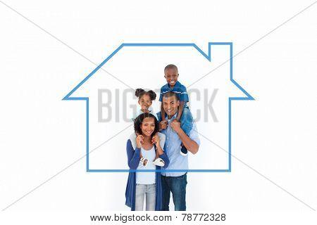 Family giving children piggyback ride against house outline