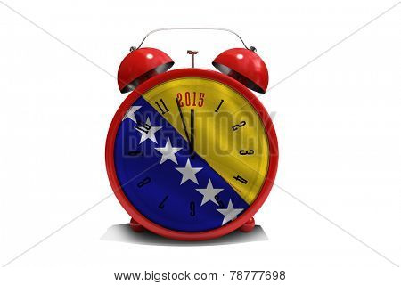 2015 in red alarm clock against digitally generated bosnian flag
