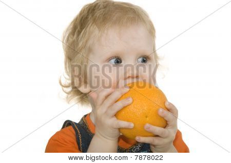 Child Bites Orange