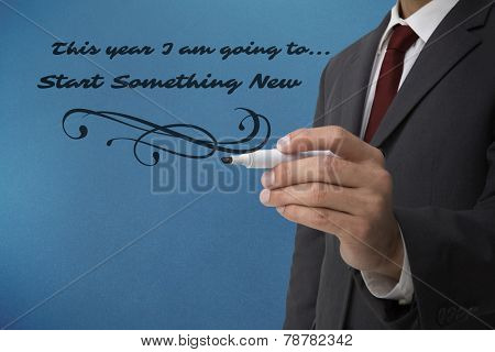 Classy businessman holding a marker against blue background with vignette