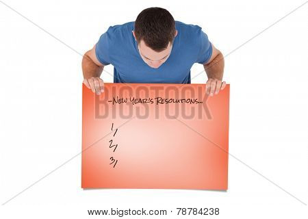 Portrait of a man looking at a blank panel against orange card