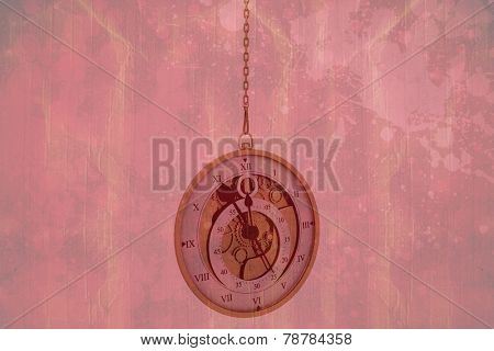 Hanging pocketwatch against red paint splashed surface