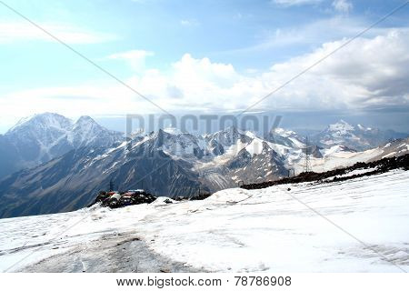 Ice Slope Of Mount Elbrus Against The Big Caucasian Spine