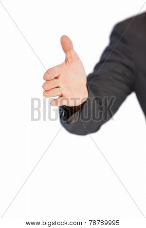 Businessman extending arm for handshake on white background