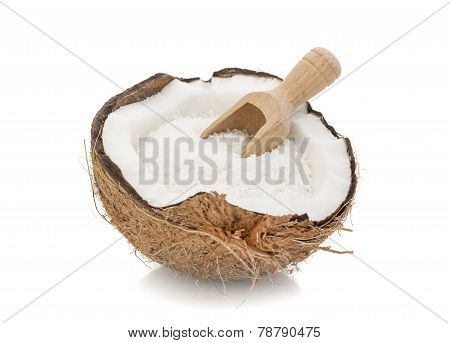 Desiccated Coconut and Wooden Scoop