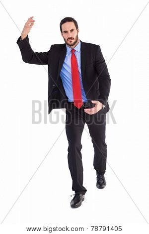 Unsmiling businessman holding something with hands on white background