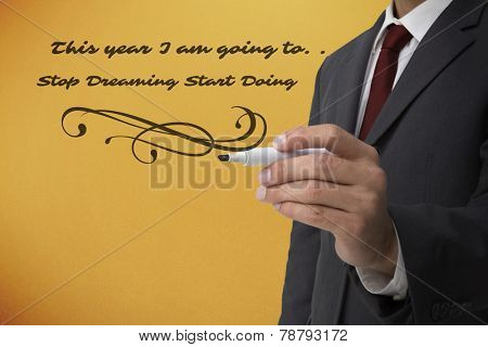 Classy businessman holding a marker against yellow background with vignette