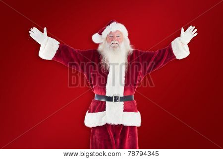 Jolly Santa opens his arms to camera against red background