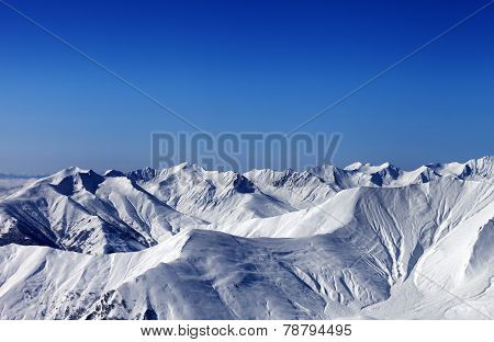 Winter Snowy Mountains With Avalanche Slope At Evening