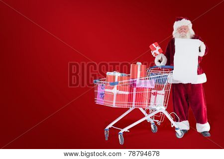 Santa spread presents with shopping cart against red background