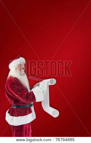 Father Christmas writes a list against red background
