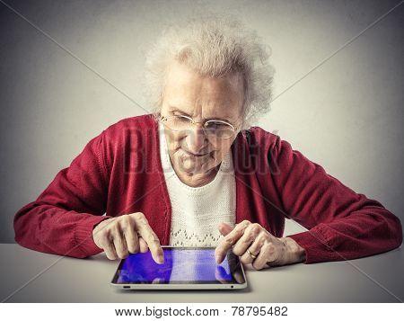 A smart grandma using a tablet