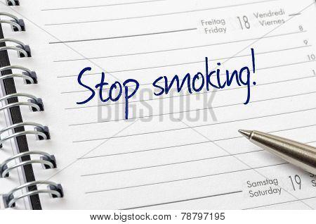 Stop smoking written on a calendar page