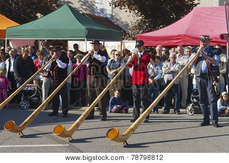 Men perform music with alpenhorns in Affoltern Im Emmental, Switzerland.
