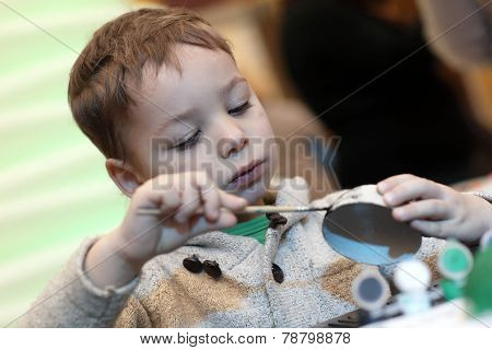 Boy Making Cardboard Toy