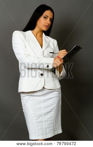 Businesswoman Holding A Pen Requesting A Signature On A Document