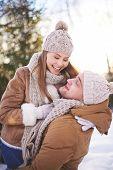 foto of amor  - Amorous and joyful couple having fun in winter outdoors - JPG