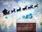 image of santa sleigh  - Santa flying his sleigh behind chimney against twinkling stars - JPG