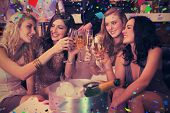 pic of champagne color  - Pretty friends drinking champagne together against flying colours - JPG