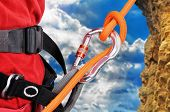 image of mountain-climber  - climber climbing a rope on a rock - JPG
