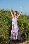 stock photo of minx  - Happy young woman with dreadlocks on nature background - JPG