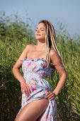 picture of minx  - Happy young woman with dreadlocks on nature background - JPG