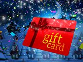 picture of quaint  - Santa flying his sleigh behind gift card against quaint town with bright moon - JPG