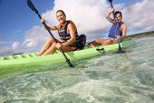 foto of west indies  - Couple canoeing in lagoon of West French indies - JPG