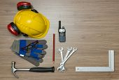 picture of personal safety  - Background with various personal safety accessories and assorted tools on a wooden surface - JPG