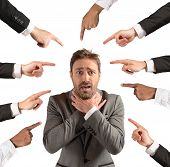 foto of insulting  - Businessman accused and insulted by his team - JPG