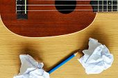 pic of bluegrass  - ukulele guitar with paper scraps and pencil - JPG