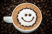 foto of latte coffee  - Closeup of a beautiful cup of hot coffee on coffee bean background - JPG