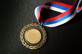 image of medal  - Metal medal with tricolor ribbon in closeup - JPG