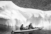 image of canoe boat man  - Two men in a canoe among icebergs in Antarctica - JPG