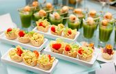 foto of banquet  - Various snacks on glass platter - JPG