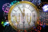 foto of count down  - Clock counting down to midnight against three full glasses of champagne - JPG