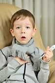 picture of cough  - boy coughing and holding a thermometer vertical - JPG