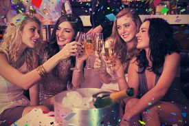 foto of champagne color  - Pretty friends drinking champagne together against flying colours - JPG