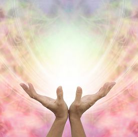 foto of senses  - Female hands outstretched sensing a beautiful pastel colored Angelic energy field with a ball of white light at the center and plenty of copy space around - JPG