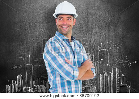 Smiling male worker standing arms crossed against hand drawn city plan