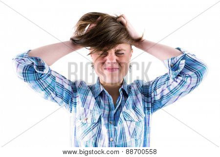 Pretty brunette getting a headache with hands on head on white background