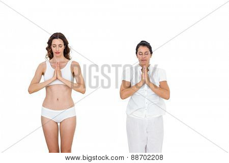 Relaxed women doing yoga on white background
