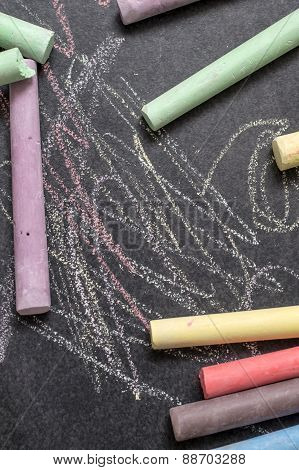 Colored Chalk On A Blackboard Background