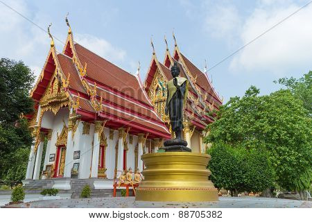 Place of worship with black standing buddha statue