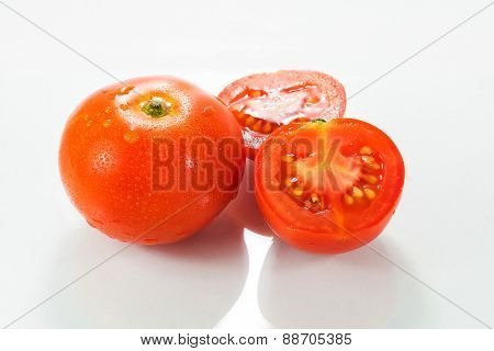 Tomatoes. Whole And A Half Isolated On White